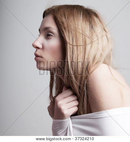 Worried Sleepy Half-dressed Pale Woman In White Clothes