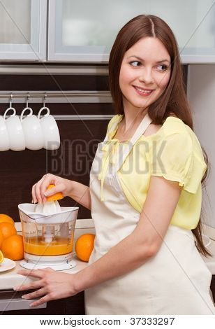 Beautiful Woman Making Orange Juice