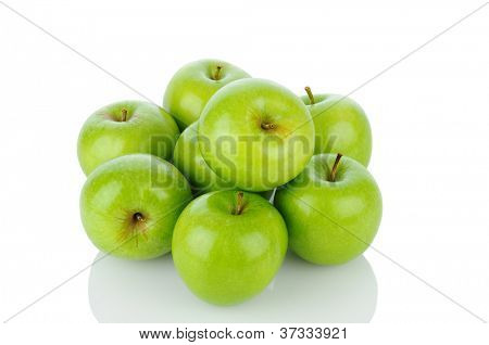 A pile of Granny Smith apples on white with reflection. Horizontal format.