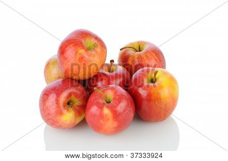 A pile of Gale Apples on white with reflection. Horizontal format.