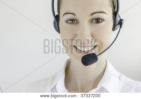 Successful female call centre employee speaking over the headset