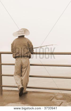 Fisherman On Pier