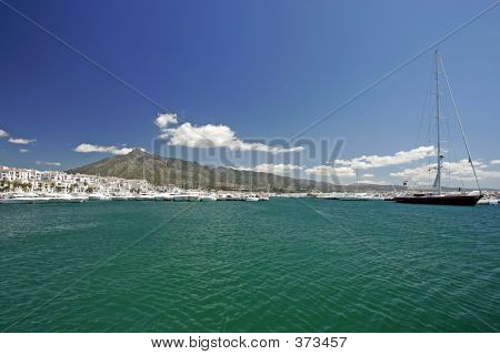 Stunning Landscape Views Across Clear Waters Of Port Or Harbour In Spain