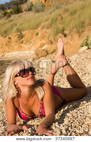 The Sexual Young Blonde Girl On A Beach