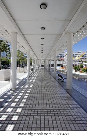 Four Long Converging Lines From Inside A Walkway In Modern Square