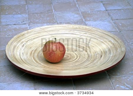 Red Apple On A Big Wooden Plate
