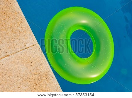 Bright colored floater in a swimming pool