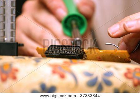 Man Repairing Scart