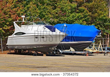 power boat with blue shrink wrap