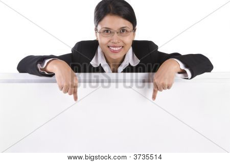 Business Woman Pointing To The Whiteboard