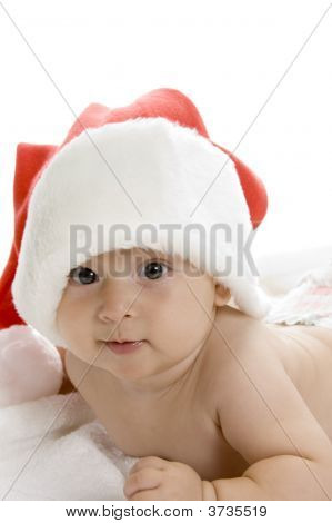 Smiling Toddler Wearing Red Christmas Cap