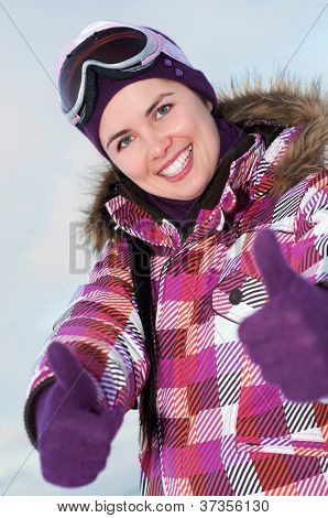 Smiling happy young woman outdoors in winter