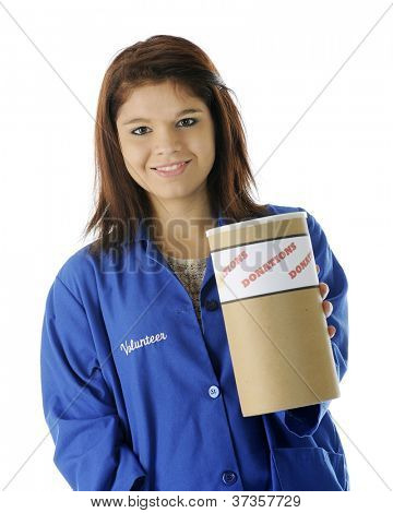 A pretty young volunteer happily holding out a donation can for your contribution.  On a white background.