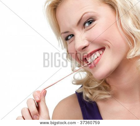 Blond woman and chewing gum, isolated on white