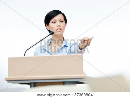 Female lecturer at the board. Business meeting