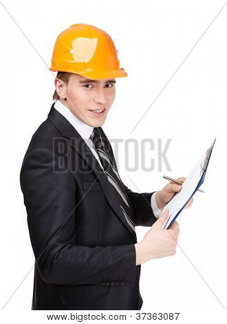 Making notes man in orange helmet and suit, isolated on white