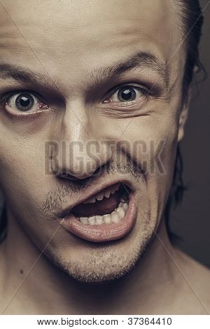 Close-up Of Crazy Man With Funny Facial Expression