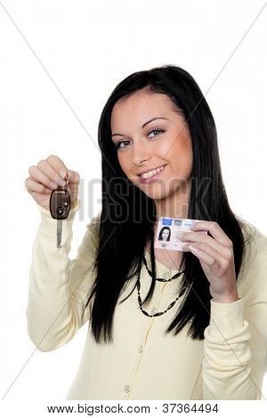 woman with car keys and driver's license. driving test