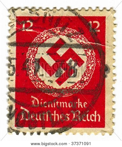 GERMANY - CIRCA 1941: A stamp printed in Germany shows image of the swastika  is an equilateral cross with four arms bent at right angles, in red, circa 1941.