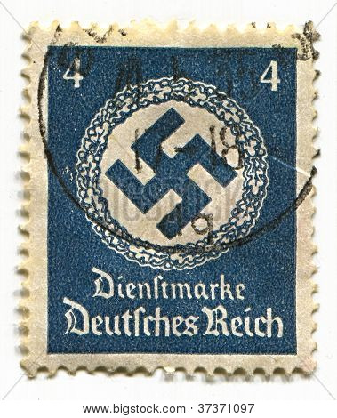 GERMANY - CIRCA 1937: A stamp printed in Germany shows image of the swastika  is an equilateral cross with four arms bent at right angles, in blue, circa 1937.
