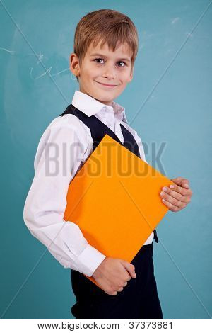 ?ute Schoolboy Is Holding An Orange Book