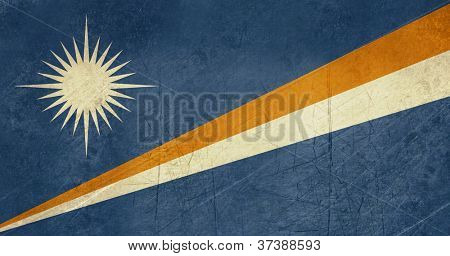 Grunge sovereign state flag of country of Marshall Islands in official colors.