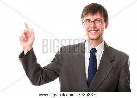 Handsome businessman pointing at copyspace over white background
