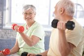 stock photo of casual wear  - Vital senior couple exercising in the gym - JPG