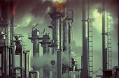 oil, gas and fuel industry, pollution and toxic clouds. focal point on the pipes close to the clock.