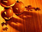 stock photo of jack o lanterns  - Picture of halloween glowing pumpkins border - JPG