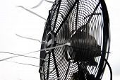 stock photo of heatwave  - retro classic table fan close up over white - JPG