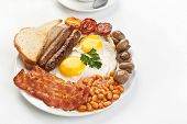 Traditional English breakfast - egg, sausages, beans and bacon