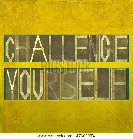 "Textured background image and design element depicting the words ""Challenge yourself"""