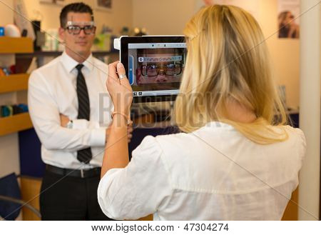 Optician Or Optometrist Measuring The Eye Distance Of A Customer