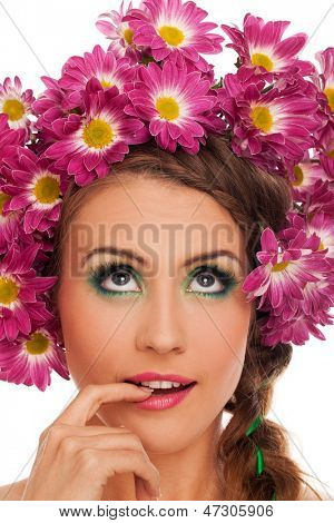 Young beautiful woman with flowers in her hair and expressive makeup
