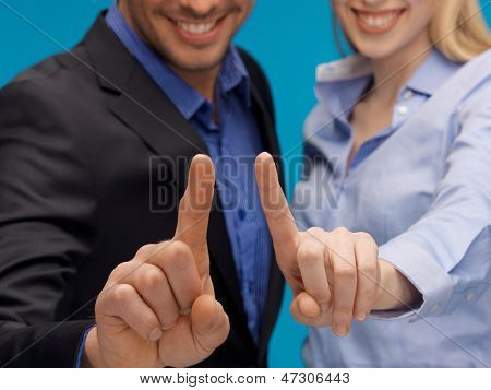 picture of man and woman hands pointing at something