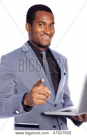 Portrait of a smiling business man holding a laptop - isolated over a white background