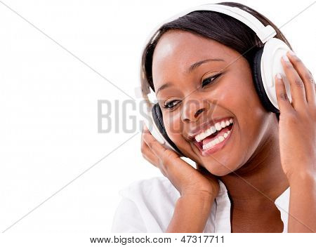 Happy woman listening to music with headphones - isolated over white