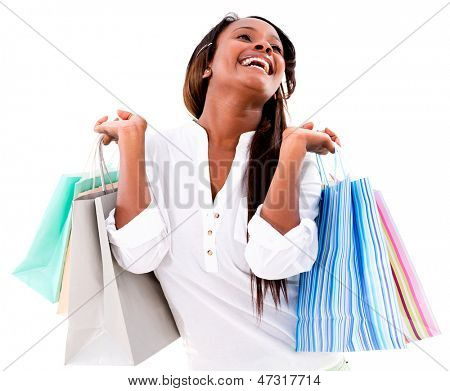 Excited shopping woman holding bags and smiling - isolated over white