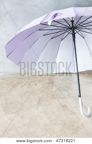 Violet Silver Bronze Uv Protection Umbrella On The Floor
