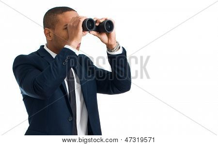 Businessman Looking Through Binocular Over White Background