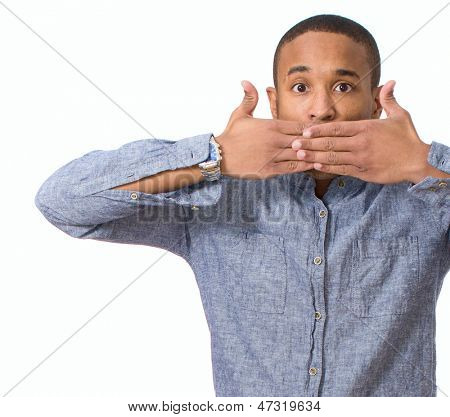 Portrait Of Young African Man Covering Mouth Over White Background