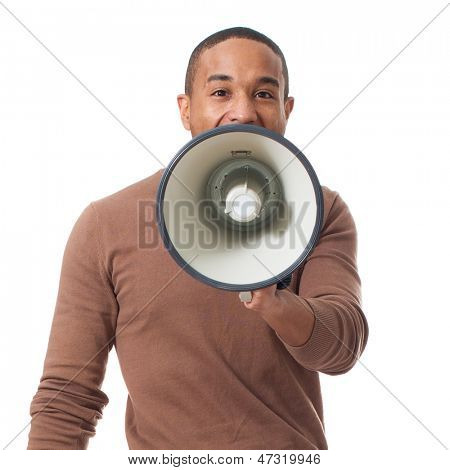 Young Man Shouting Through Megaphone Over White Background