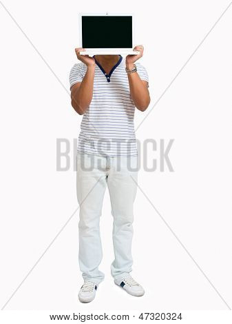 Young African Man Hiding Face With Laptop Over White Background