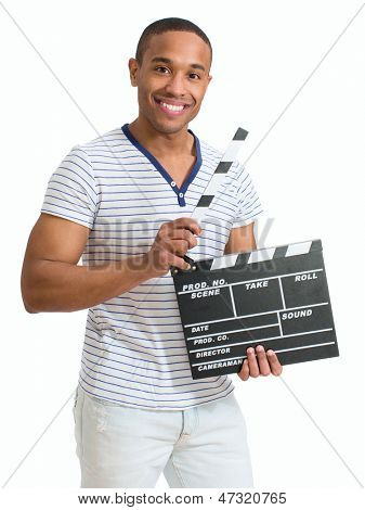 Young Happy African Man Clapboard Over White Background