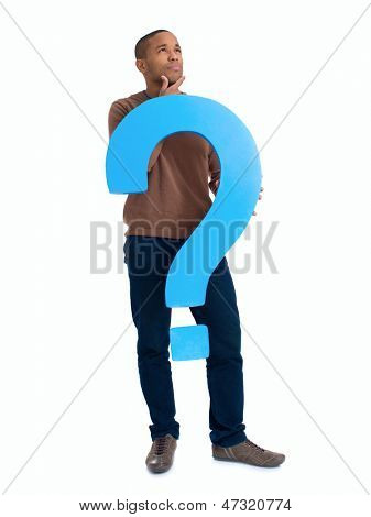 Contemplated Man Holding Question Mark Sign Over White Background