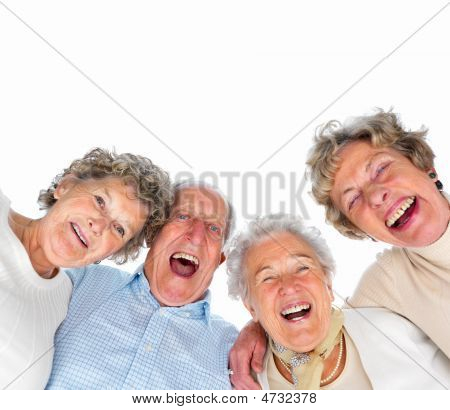 Portrait of a group of happy old people smiling over white background