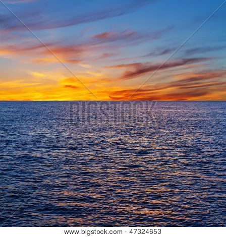Sunset cloudscape over water