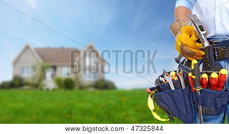 Worker with a tool belt. Construction and house renovation concept.