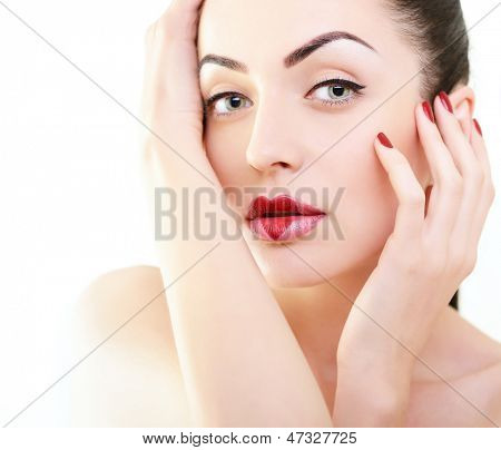 Woman in love. Beautiful girl with creative makeup with heart on her lips posing at studio over white background